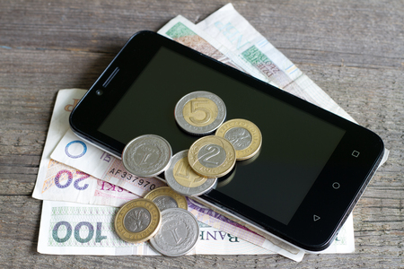 unbranded: Cell phone and polish money closeup