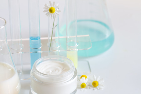Natural herbal healthy cosmetics in the lab abstract with chamomile Archivio Fotografico