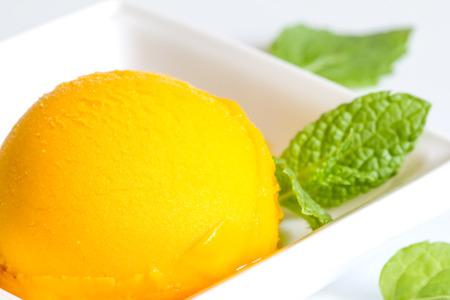 sherbet: Mango sherbet with mint closeup