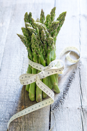 Asparagus and centimeter healthy lifestyle and diet abstract concept