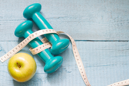 fitness gym: Fitness and diet abstract concept with dumbbells
