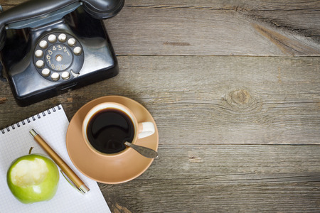 office supplies: Old vintage wooden table in workplace business office and free space Stock Photo