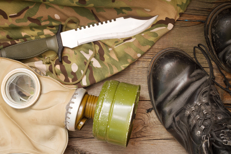 matchmaker: Military accessories on wooden boards abstract background Stock Photo