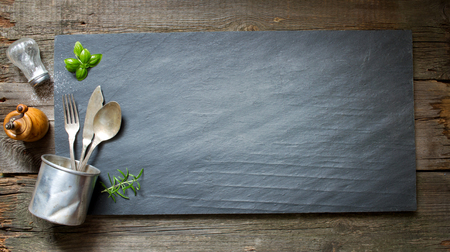 grunge cutlery: Old retro culinary menu abstract background on black stone Stock Photo