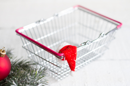 hollidays: Christmas and empty shopping basket abstract concept
