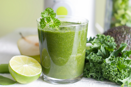 Green smoothie with fruits and vegetables food diet concept Stock Photo