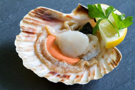 Raw scallops with lemon seafood closeup concept Stock Photo