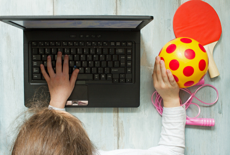 laptop computers: Internet addiction and computers concept with kid and laptop Stock Photo