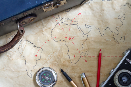 space travel: Travel plan abstract concept with old maps suitcase and camera