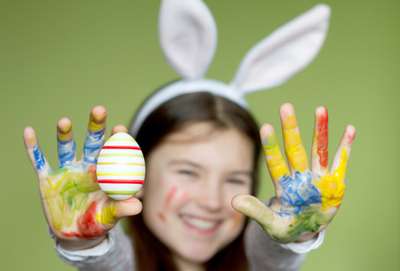 Smiling little girl with colored easter eggs photo