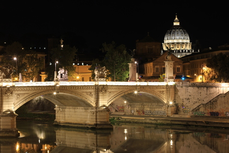 Rome by night St Peters Basilica and river Tiber