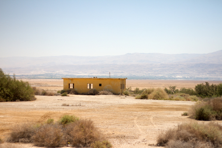 Palestine desert near dead sea and lonely house