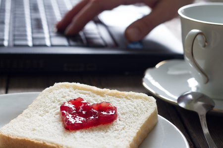 I love business concept with laptop breakfast jam heart shape and coffee