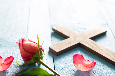 Cross and rose abstract easter religion concept background