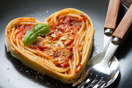 Spaghetti pasta heart love italian food diet concept on black background