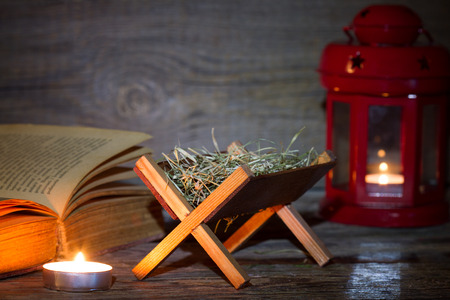 Manger nativity scene lantern on night abstract christmas background 免版税图像