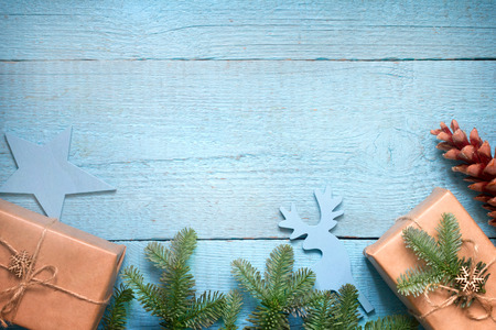 Simple gifts and fir tree. Christmas ornament on wooden background Stock Photo