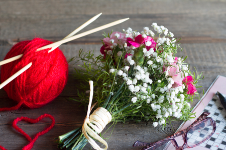 Grandparents day concept with knitting crossword and bouquet of flowers 写真素材
