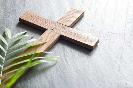 Easter wooden cross on black marble background religion abstract palm sunday concept Foto de archivo