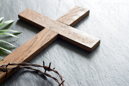 Easter wooden cross on black marble background religion abstract palm sunday concept 免版税图像