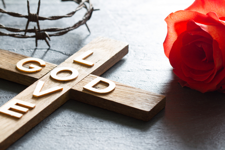 Easter christian wooden cross with an inscription god is love 写真素材