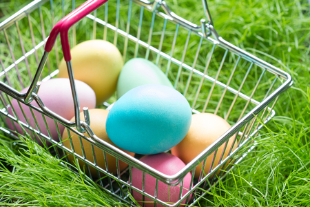 Easter eggs in a basket basket on the grass