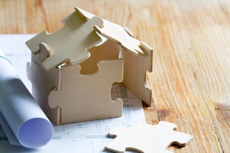 パズルと計画費で家 写真素材