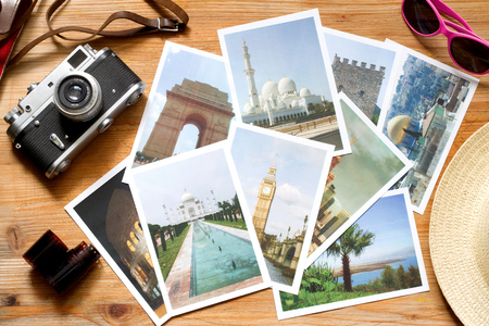 Old retro pictures on wooden table globetrotter photography travel concept