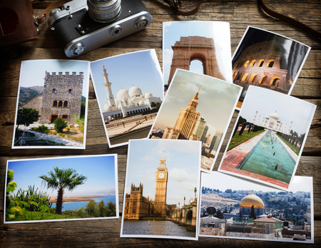 Old retro pictures and camera on wooden table globetrotter stock photography travel collage concept
