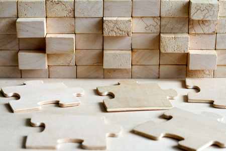 Wooden block and puzzle abstract team corporation concept background Stockfoto