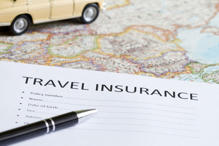 Travel insurance concept with car and map