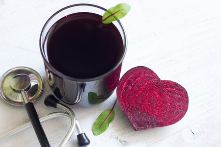 Healthy beetroot with heart shape and juice
