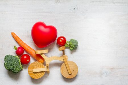 Healthy lifestyle vegetarian food on the bike abstract diet and sport concept with heart Stock Photo