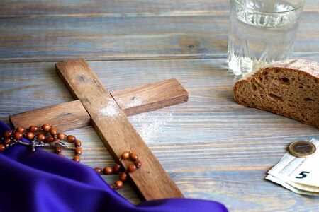 Prayer almsgiving fasting Ash Wednesday concept with wooden cross