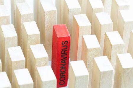 Coronavirus domino effect infecting and economy business disaster concept Stock Photo
