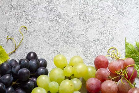 Mix of fresh ripe grapes on light background Standard-Bild