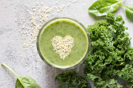Healthy green smoothie with heart of seeds linseed