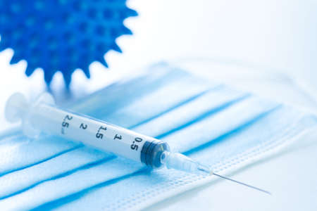 Injection syringe. Covid-19 coronavirus vaccination concept