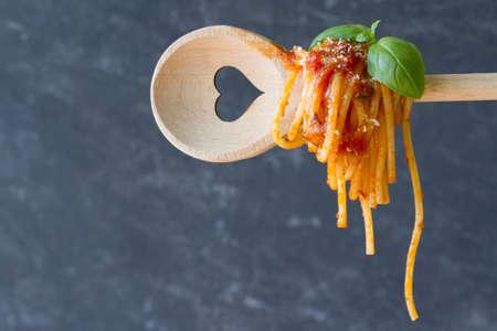 Spaghetti on spoon with heart Standard-Bild