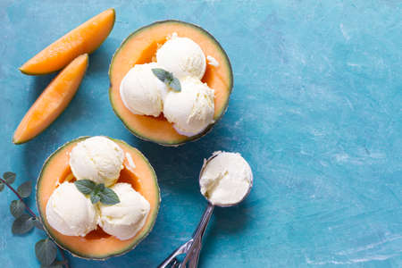 Delicious ice cream with mint leaf in melon halves