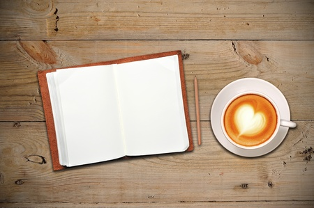 Open notebook with cup of coffee photo