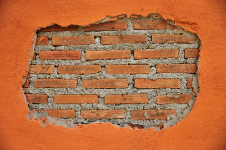 A  cracked wall reveal a brick wall inside Stock Photo - 9793312