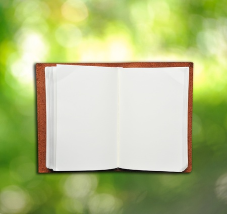 Open leather memo book with green light background  photo