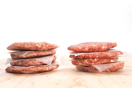 Stack of raw burger on a table  photo