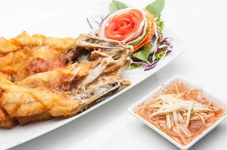 Fried fish served in white dish  photo
