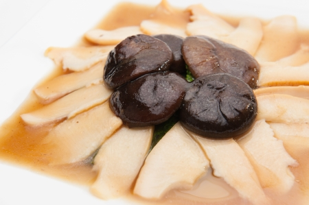 Abalone slices in red sauce served with Shiitake mushroom  photo