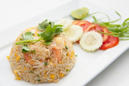 fried rice: Shrimp fried rices served on white dish