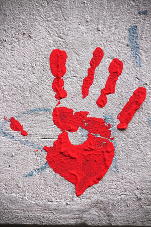 handprint: Red handprint on the wall
