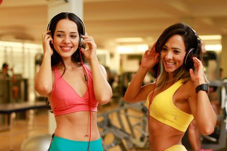 music figure: women listening music in gym