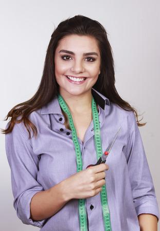 cordon tape: seamstress with cordon tape and scissors